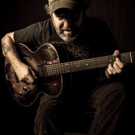 Scott H Biram Close Up Promo Photo by Christopher Cardoza